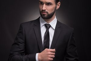 man handsome beard cuff links suit