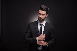 young man cuff links suit elegant