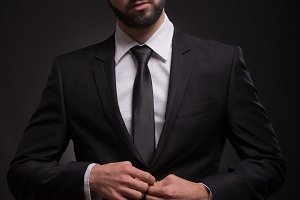 man handsome serious suit black