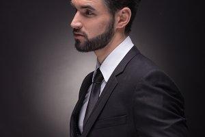 man unbuttoning jacket suit elegant