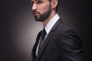unbuttoning suit jacket man elegant