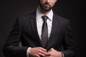 serious man suit elegant looking
