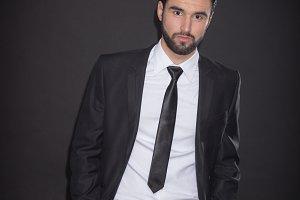 man posing suit shirt tie pants