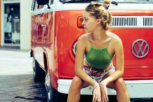 hippie girl near an orange bus