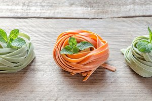 Colorful rolled pasta on the wooden