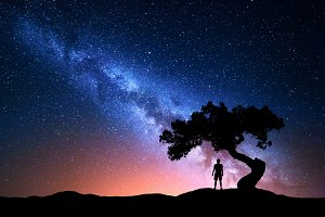 Man under the tree against Milky Way