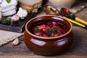 borsch soup and garlic on the table