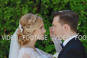 Bride and groom outdoor look at each other