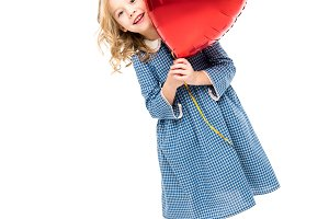 Girl with heart shaped balloons
