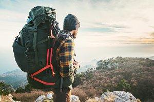 Traveler with big backpack hiking