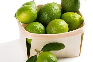 Box full of lime fruits.
