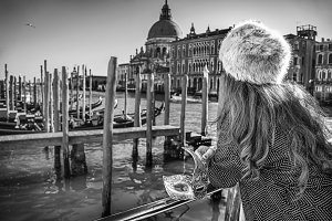 Venetian mask in hand of woman in Venice, Italy