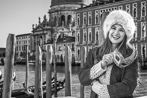 happy elegant woman in Venice, Italy with Venetian mask