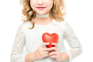 Girl with red heart sign