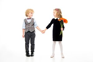 Children with flower holding hands