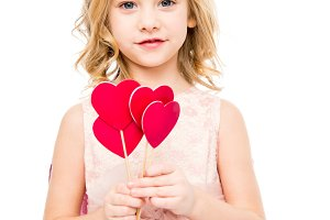 Girl with red hearts on sticks