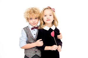 Kids with red paper heart on stick