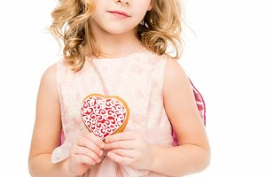 Girl with heart shaped cookie