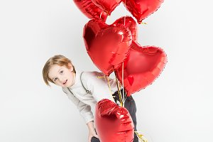 Boy with bundle of balloons