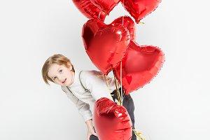 Boy with bundle of balloons