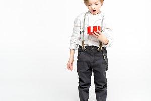 Boy looking inside of present