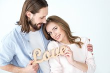 Couple holding Love word