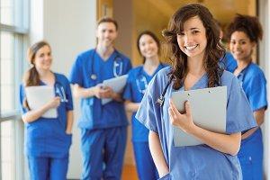 Medical students smiling at the camera