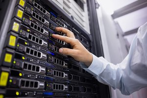 Technician working on server tower
