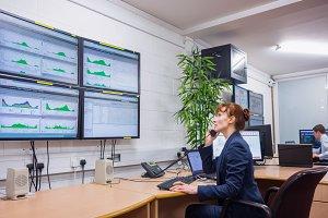 Technician sitting in office running diagnostics
