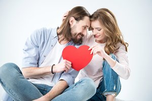 Couple with red paper heart