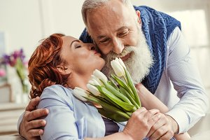 Mature couple with tulip flowers