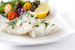 Fried cod fillet and salad