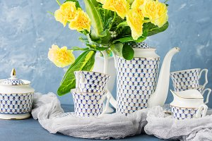 Easter tea party festive set and yellow flowers