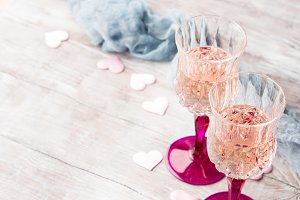 Two pink champagne glasses for romantic date
