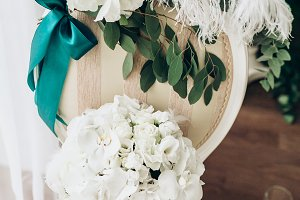 wedding bouquet of white roses on the chair, close-up