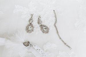 Wedding jewelry on wedding dress, close-up