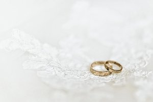 Wedding rings on wedding dress, close-up