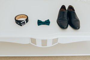 Trendy men's strap bow tie and shoes. Accesories, close-up