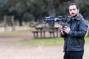 man Operating The Drone