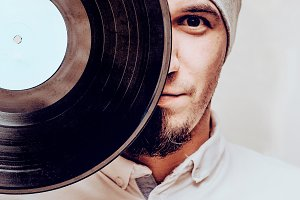 stylish man with vinyl record