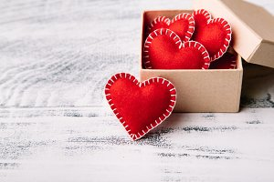 Gift box with red felt hearts for Valentine's day