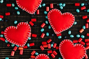 Red hearts from felt on the table