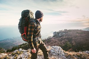 Man traveling with backpack hiking