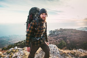 Bearded Man hiking in mountains