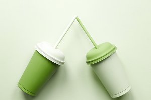 Two green plastic cups