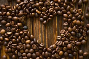 "Background made of coffee beans with message ""I love c?ffee!"""