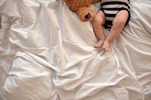 Cute baby girl sleeping in her crib.