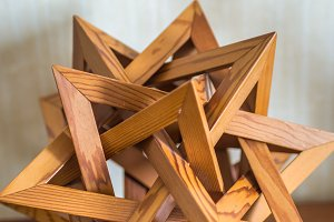 wooden abstraction of triangles