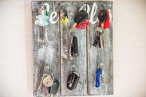 cars keys hanging on wooden board
