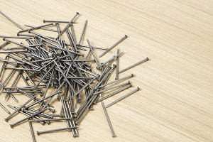 Group of iron nails on a wooden